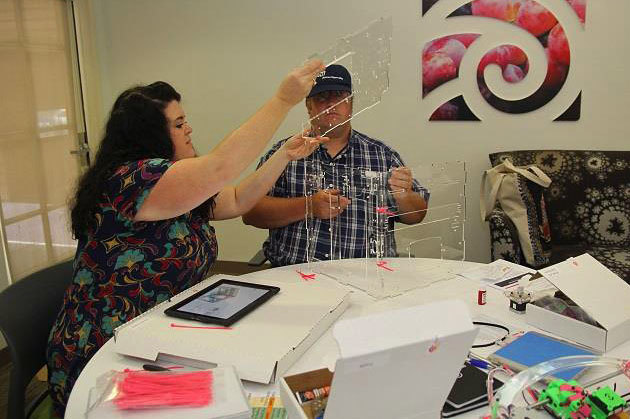 Educators assemble a JellyBOX 3D printer kit at Discovery Place Education Studio
